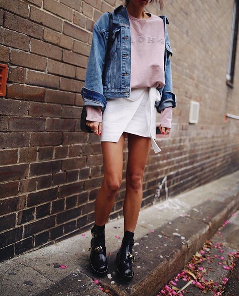 How To Wear Denim Jacket With Oversized Pink Sweater And Wrap Mini Skirt In White 2021