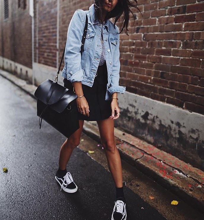 Wash Blue Denim Jacket With Mini Black Skirt And Black Trainers 2019