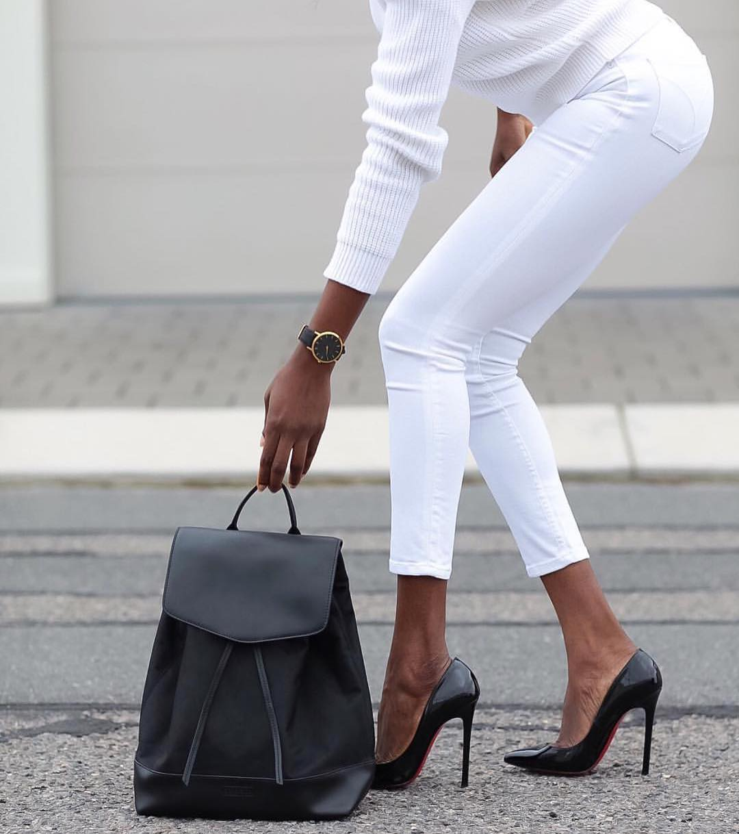 All White Outfit With Black Backpack And Black Heeled Pumps 2019