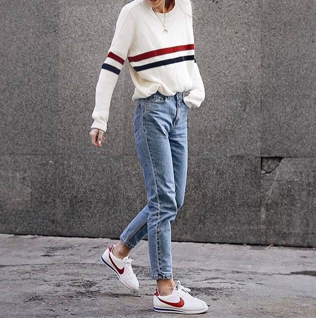 An Oversized White Sweater In Red Navy Stripes And Slim Jeans Combo 2020