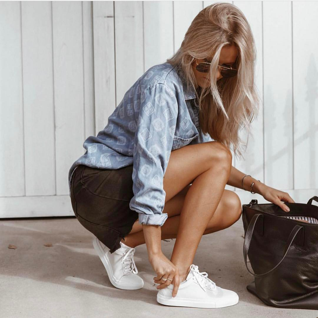 Light Blue Chambray Shirt With Brown Denim Skirt And White Sneakers 2019