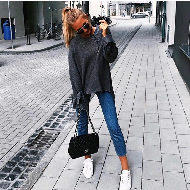 Slouchy Grey Sweater And Blue Jeans With White Kicks For Spring 2021