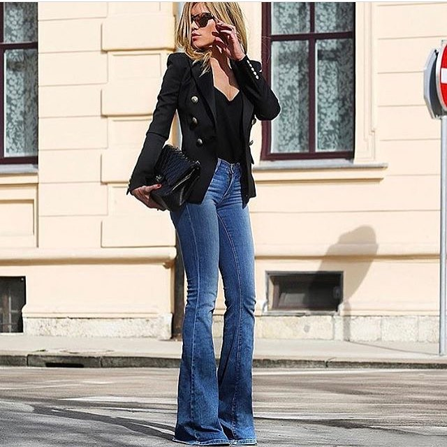 Slim Blazer In Black With Gold Buttons And Bootcut Jeans In Blue For Spring 2021