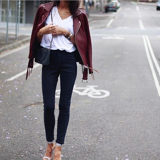 Maroon Leather Jacket With White Top, Black Jeans And Ankle Strap Sandals 2019