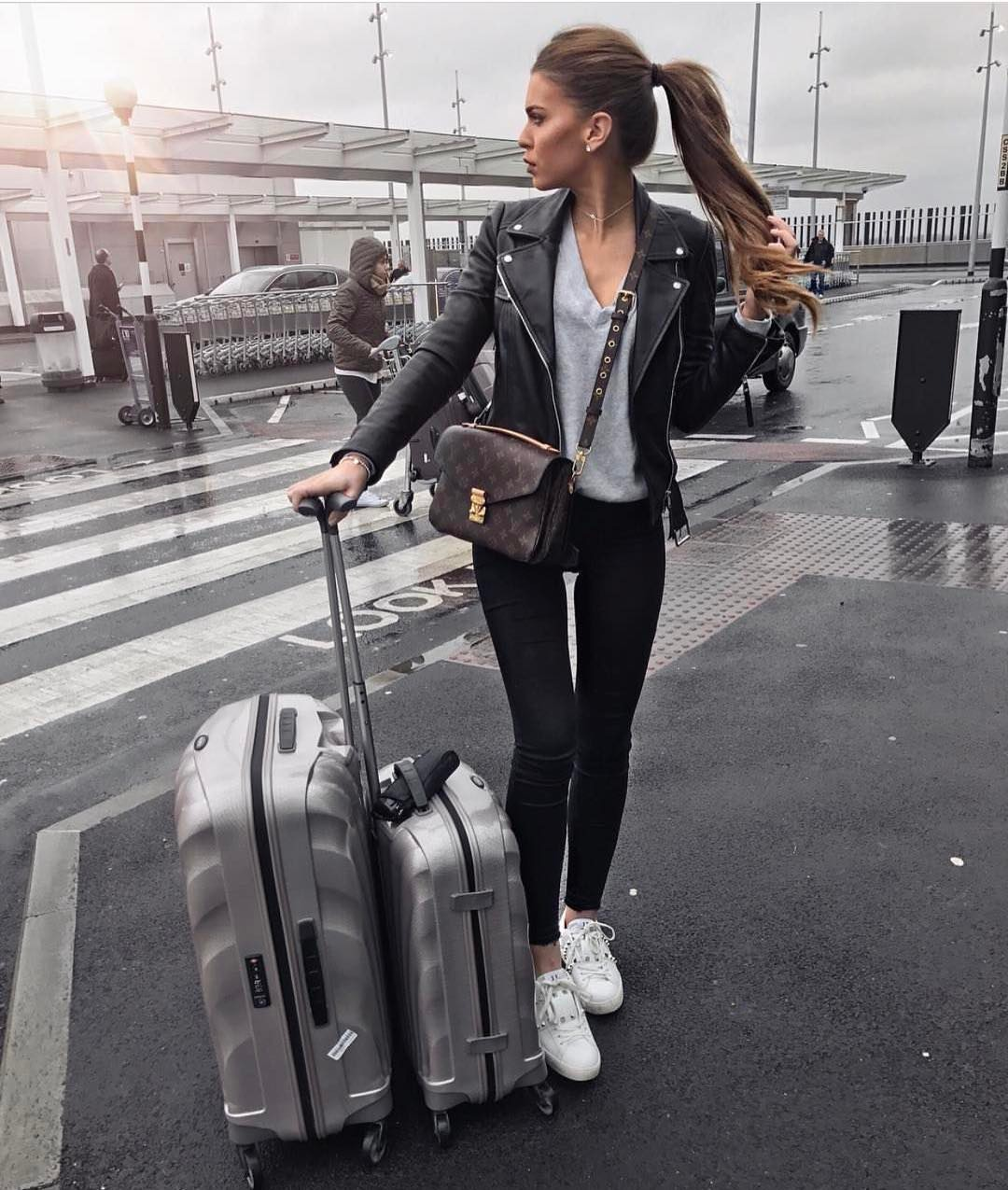 Black Leather Jacket With Grey Top And Skinny Jeans In Black: Airport Style 2019