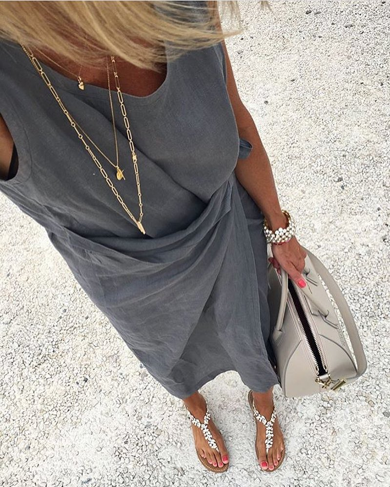 Wrap Sleeveless Dress In Grey With Layered Gold Necklaces For Boho Summer 2020