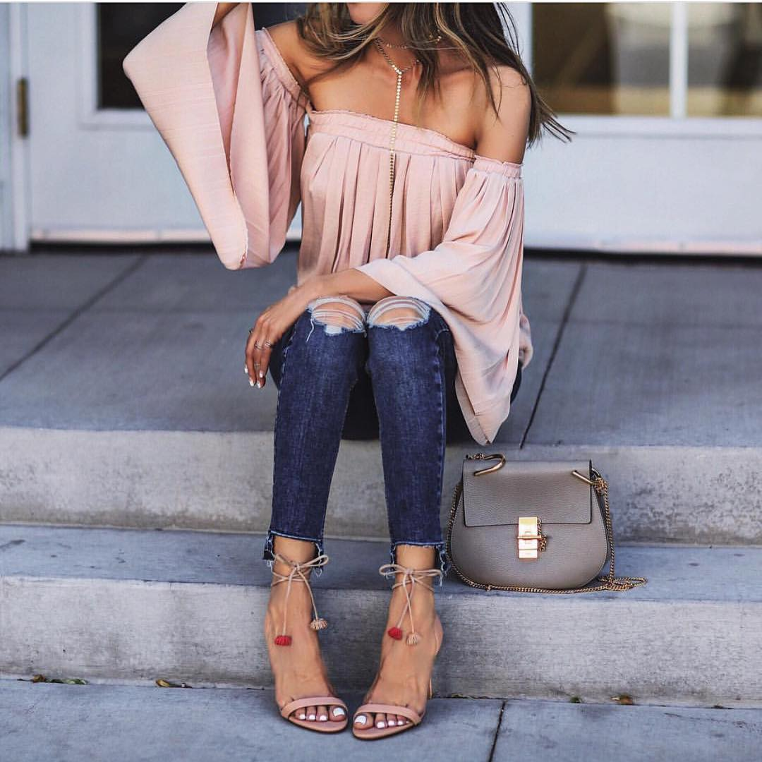 Pastel Pink Off Shoulder Blouse With Wide Sleeves And Ripped Jeans For Summer 2021
