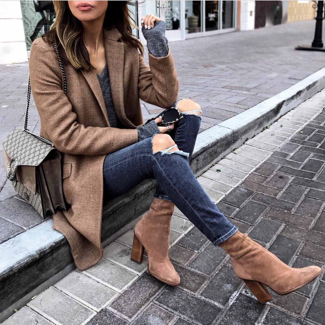 Light Brown Wool Coat With Grey Sweater And Ripped Grey Skinny Jeans For Fall 2021