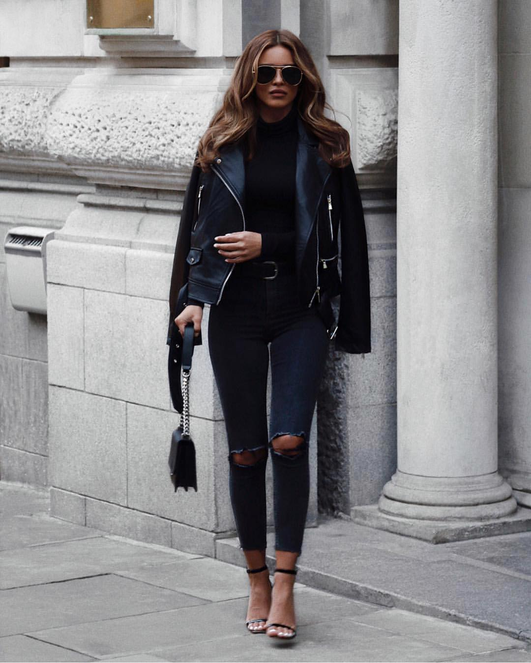 All Black Street Look: Leather Jacket, Bodysuit, Ripped Jeans And Sandals 2019