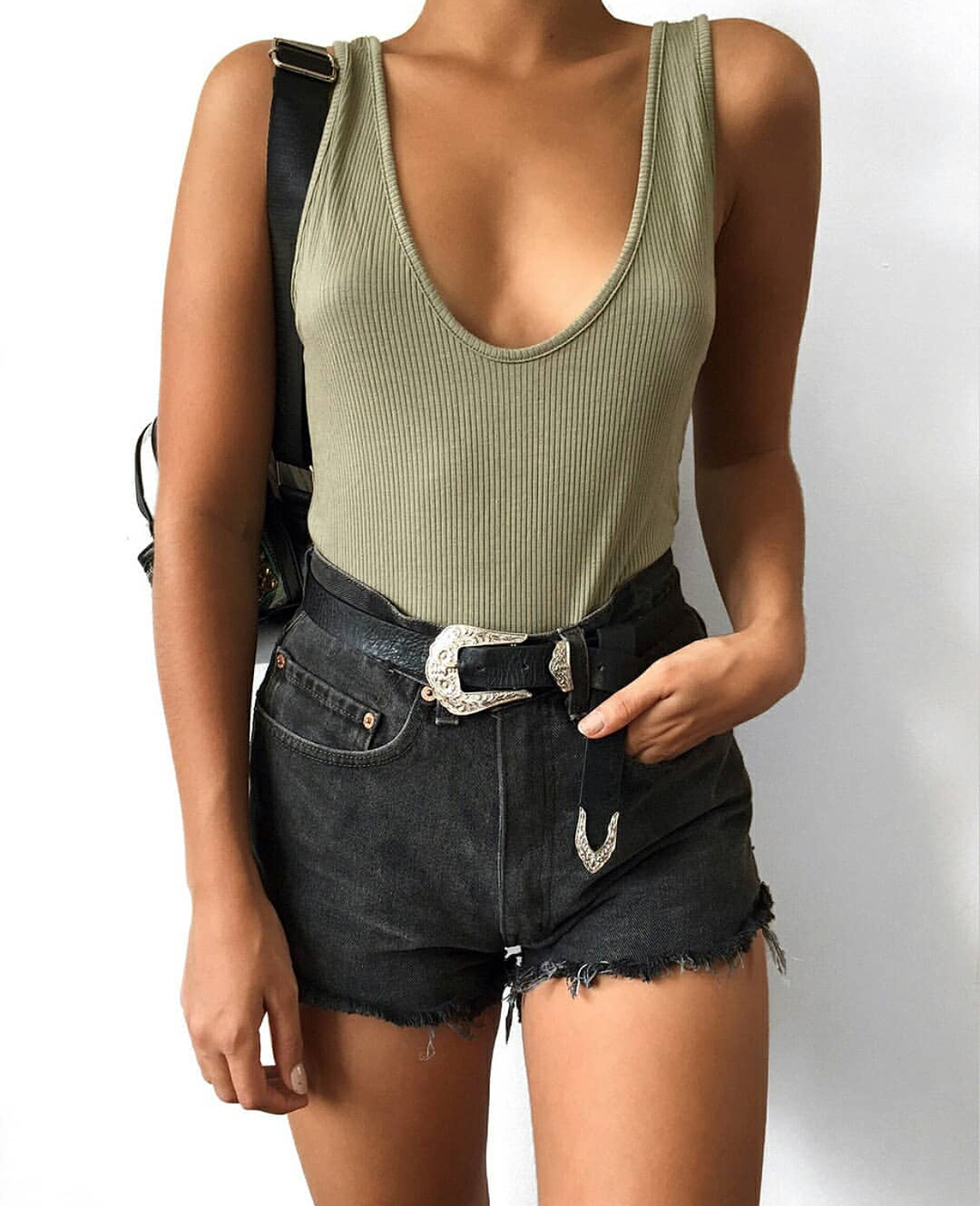 Khaki Green Bodysuit And Black Denim Shorts For Summer 2021