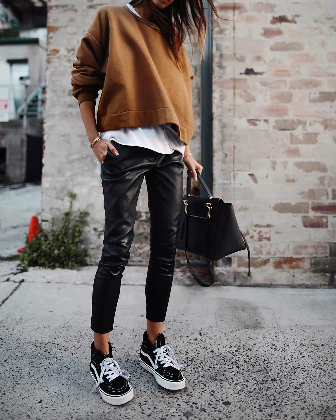 Brown Sweatshirt And Black Leather Pants With Black High Top Sneakers For Fall 2021